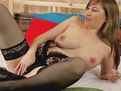 Hot mature mother playing on her bed