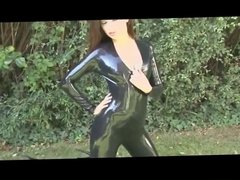 Brunette in black latex catsuit & high heels