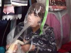 Girl in Mask Seals Herself in Vaccuum Bag