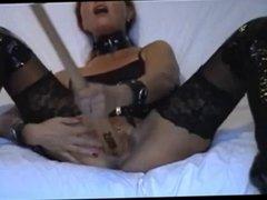 Hot Slut masturbates with bat