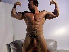 Bodybuilder Xavier shows off cock and muscles