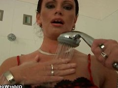 Soccer mom with big tits finger fucks in bathroom