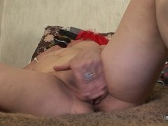 Granny loves playing with her old pussy