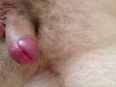 Wife teasing my cock with her tit
