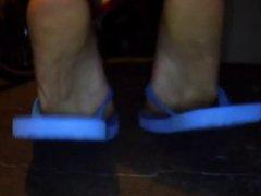 Feet in blue sandals