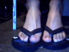 Feet in black sandals