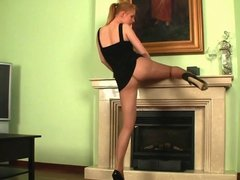 Pantyhose redhead seduces a fireplace