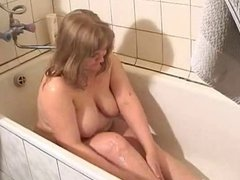 Chubby blonde is playing with her body