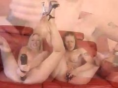 Two Women In Lesbian Action With Long Black Sex Toy