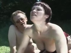 British slut gets fucked in the field in a FMM threesome