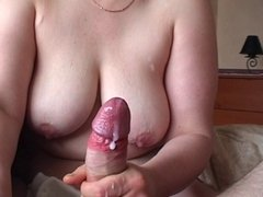 big breasted wife giving handjob