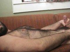 Furry man masturbating and shooting