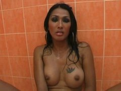 Ladyboy Pang Pond jerking off in the shower