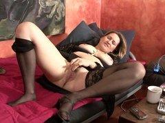 Kinky housewife playing with a huge dildo