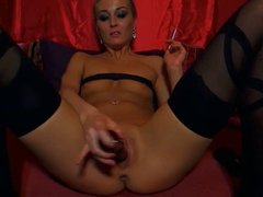 Blond Milf Smoking and toying with a Dildo