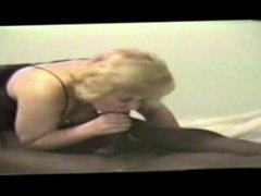 Blonde mom sucks a big black cock