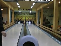 Girl in fishnets dancing kinky striptease in bowling