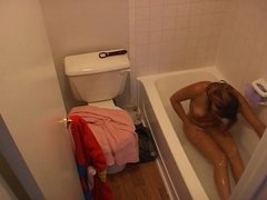 Hidden cam caught Young Girl taking a bath