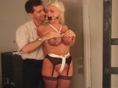 Boobacious Blonde Slut Tied to a Pole