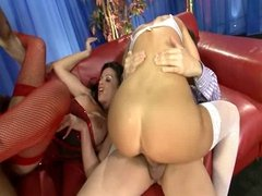 British blonde slut and friend get fucked on a red sofa