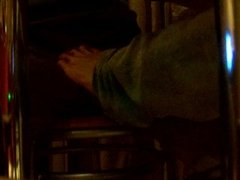 Footjob under table