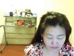 Cute Chinese slut shows tits