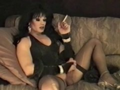 Cool Dark Haired tranny smokes & masturbates
