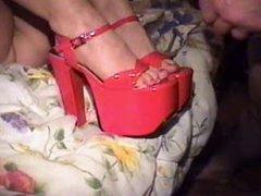 Shoejob and cumshot in platform heels