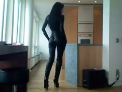 Sexy Milf In Catsuit & Boots Smoking