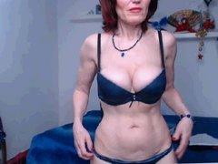 sexy 56yo mature shows off big fake tits
