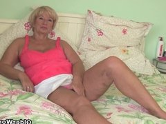 Grandma lubes up her old pussy and gets finger fucked