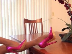 Emily teases in pink high heels