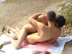 Two buddies go down on each other on a river bank