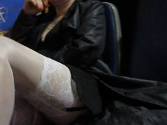 Girl spread her legs in white stockings in a bus