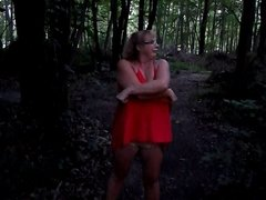 Short vid of wife taking off dress in woods