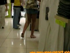 Salesgirl with great legs and skirt filmed by voyeur cam