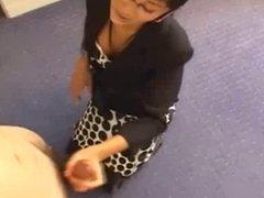 Asian businesswoman gives hot handjob