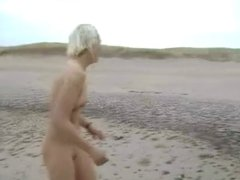 Daring Blond Bares All on a Cold Beach