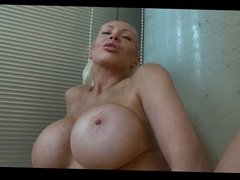 Hot blonde with big fake tits dildo-drilling her pussy