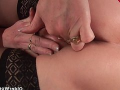 Sleazy grandma in nylons fist fucks her hairy cunt