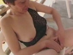 hairy mature wife rubbing her pussy in the garden