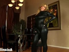 Muscle babe loves her tight body suit hugging her muscles
