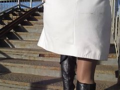 Stockings upskirt on a train station bridge