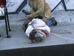 two women bound tightly on roof