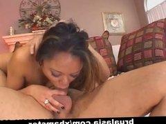 Hot Annie Cruz deep-throating a shaved cock.