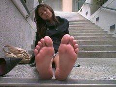 On her lunch break showing her feet