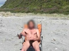 Stroking my hard cock at the beach