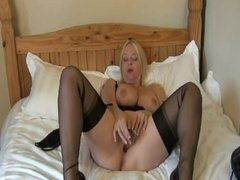 British slut Lucy G plays with a dildo on a bed