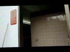 wanking in a public toilet