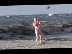 Football jock on the beach